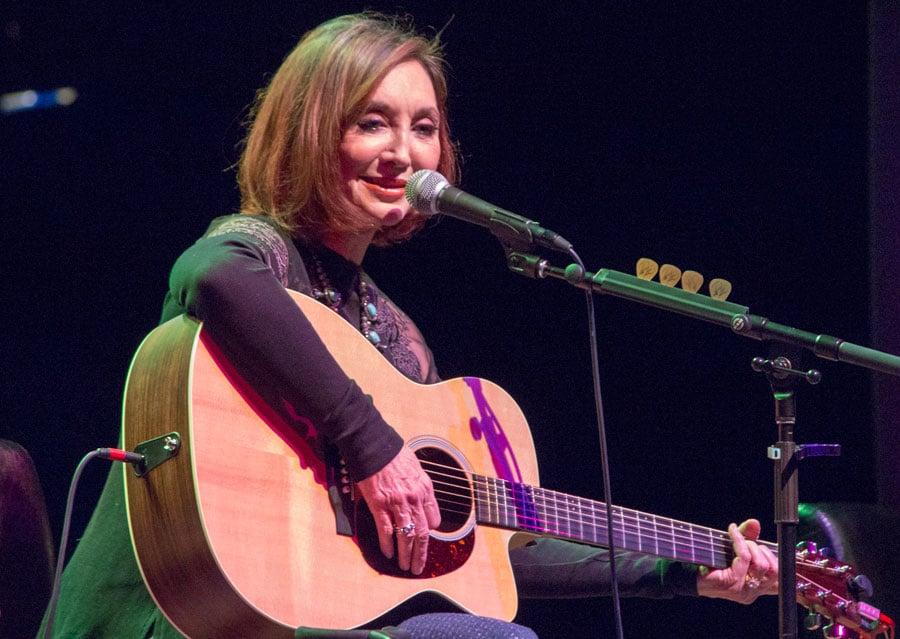 pam tillis closeup image of her playing guitar at paramount center for the arts