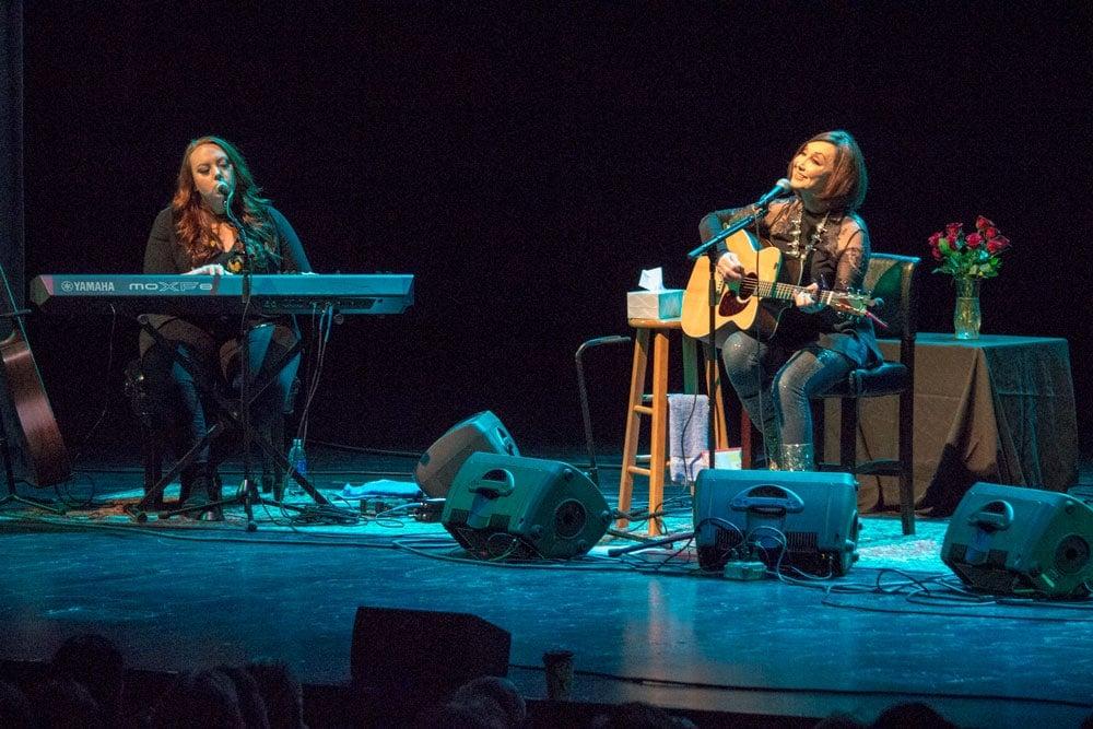 musician haley sullivan backs up pam tillis on keys and vocals on stage in st. cloud, minnesota