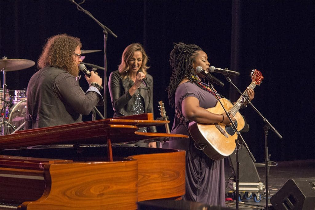 Vocal trio consisting of Bart Walker, Jenn Bostic, and Kyshona Armstrong on stage in Waconia, MN.
