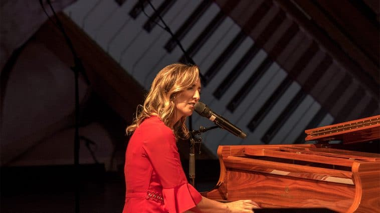 Image of Jenn Bostic alone at piano with overhead camera shot of her hands playing