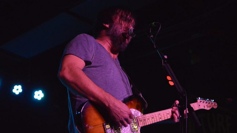 Chris Simpson of Mineral sings and plays guitar