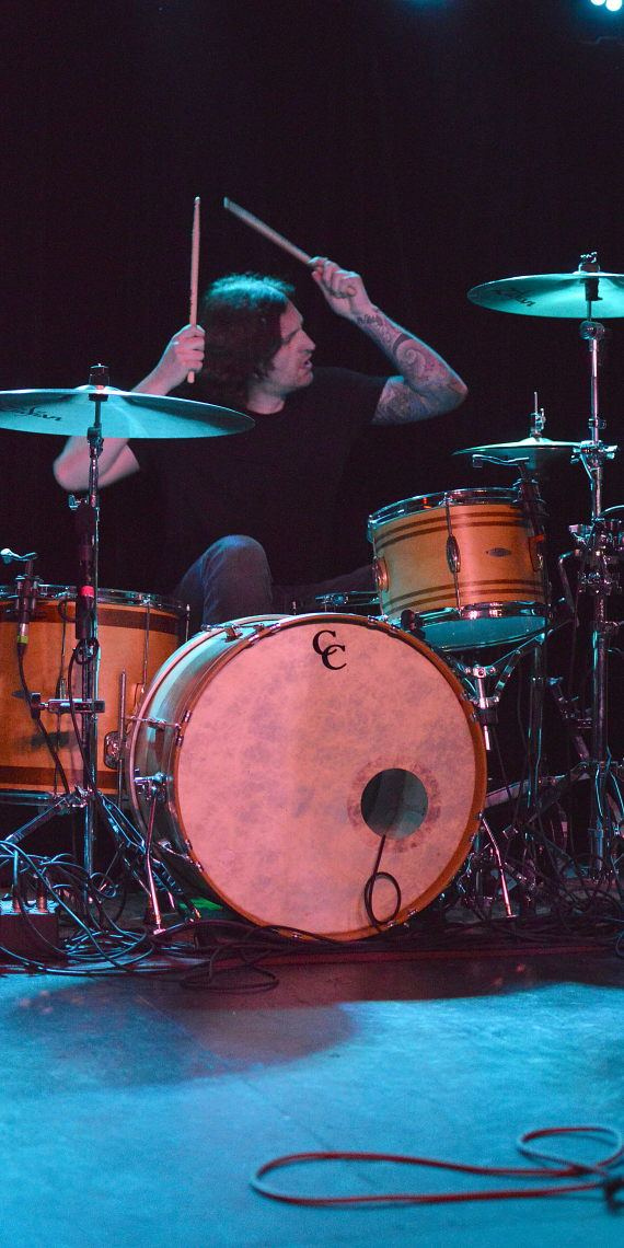 Gabriel Wiley of Mineral playing drums