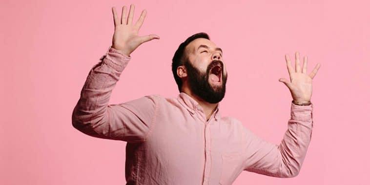 guy wearing pink shirt screaming