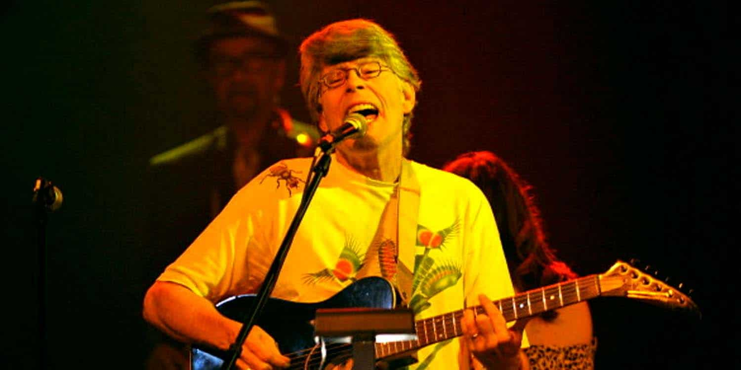Stephen King playing guitar at Word Play 2019
