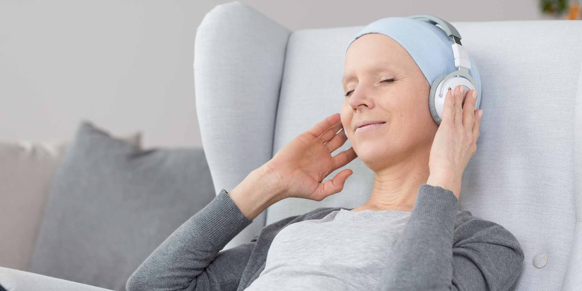 Cancer Patient Woman smiling resting listening to music headphones