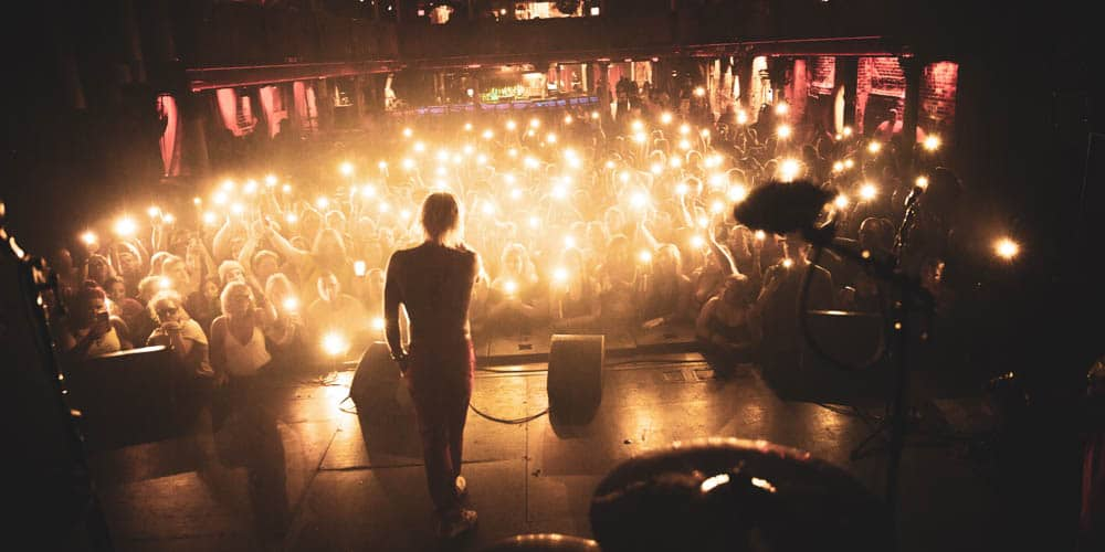 Mod Sun performing while crowd lights up venue with lights