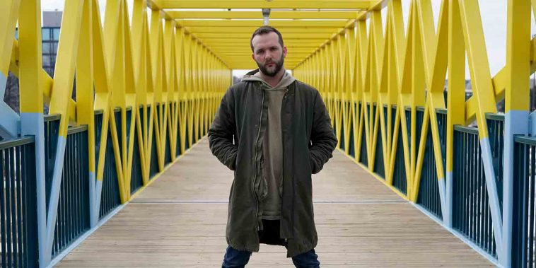 Man standing on yellow bridge minnesota