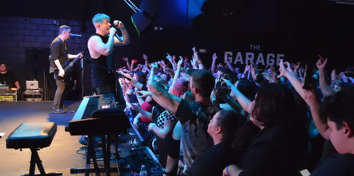 Set It Off does hand motions to his songs at The Garage venue