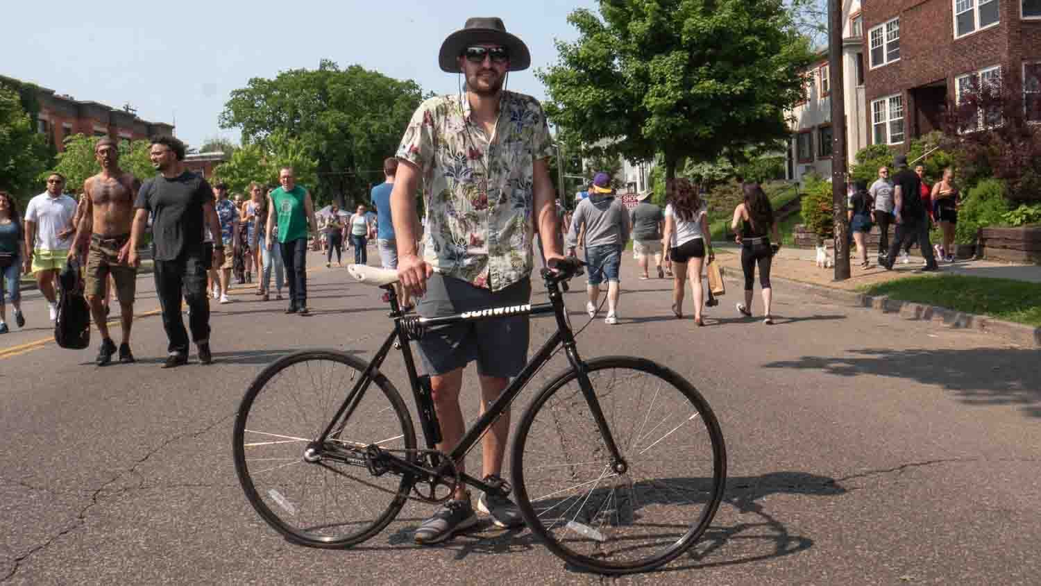 Man poses with his bicycle in Minnesota 2019