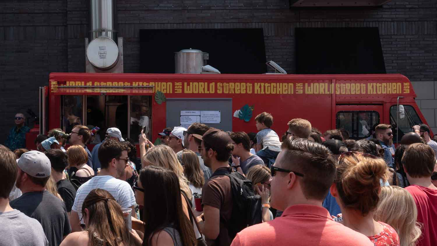 Food truck making food for crowd