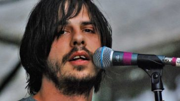 Eyedea rapping into a micrphone