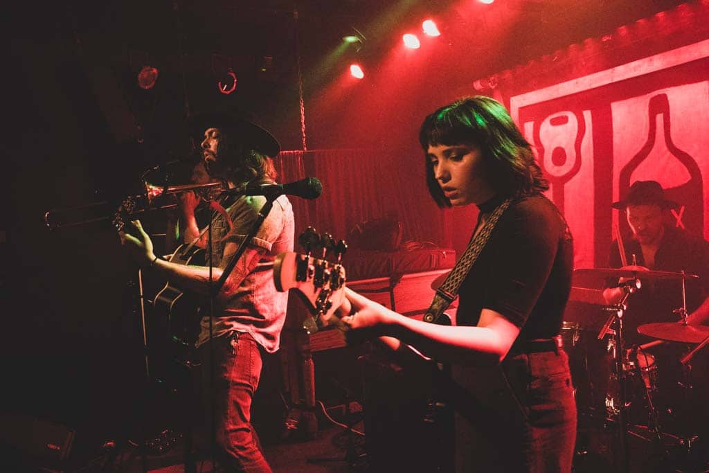 Cassandra Valentine plays bass guitar on stage