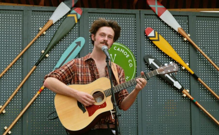 Josiah Smith plays guitar