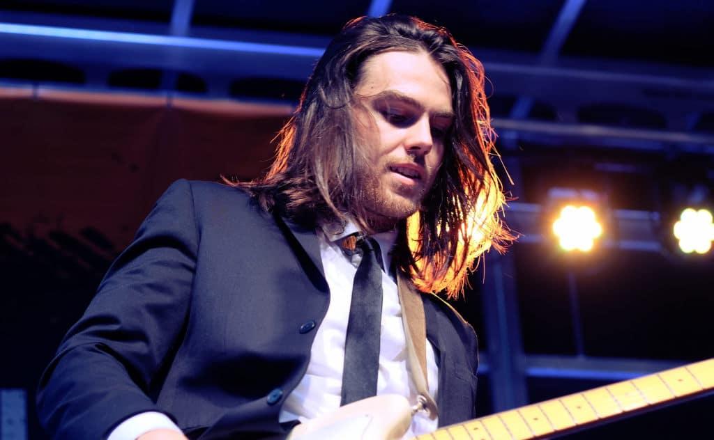 Yam Haus guitarist on stage