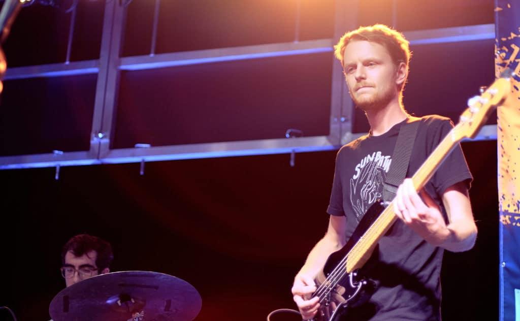 Bad Bad Hats guitarist plays on stage