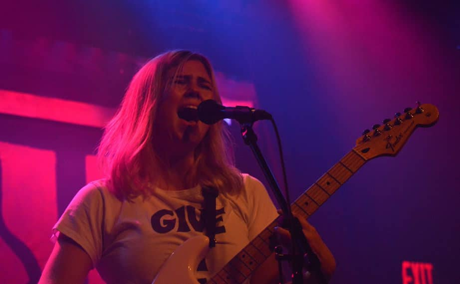 Emily Bjorke of Last Import band sings into microphone
