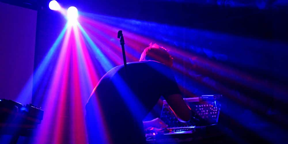 Fires of Denmark bends over his synthesizer to play a song